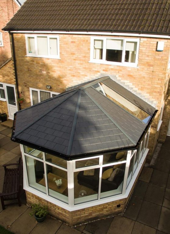 A conservatory installation with a tiled roof