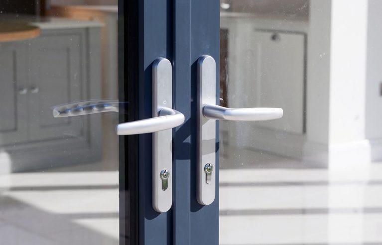 Aluminium bifold door with chrome handles