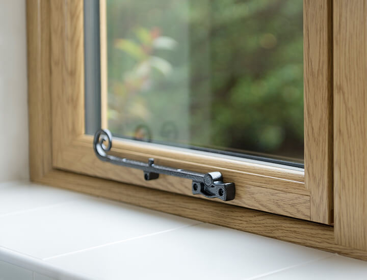 Internal view of flush sash window showing traditional style stay handle