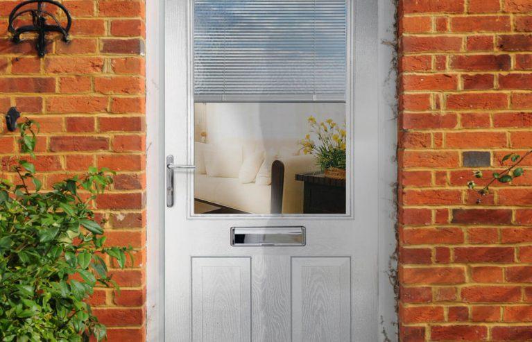 Grey composite front door with single glazed window