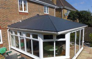 Large black tiled conservatory roof