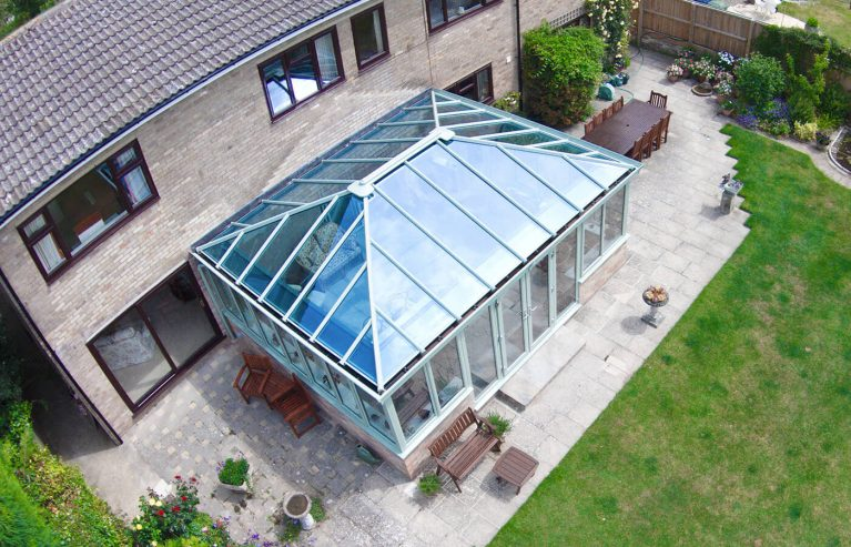 A large green uPVC conservatory