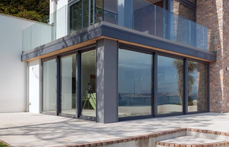 Large grey aluminium sliding patio doors