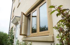 External view of oak effect flush sash window on modern home