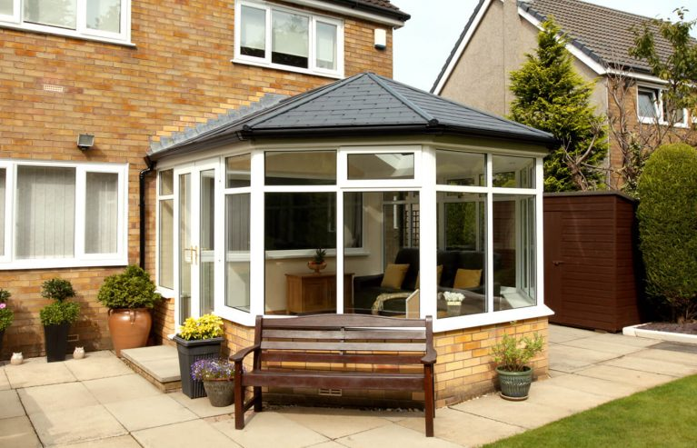 uPVC Victorian conesrvatory with a tiled roof