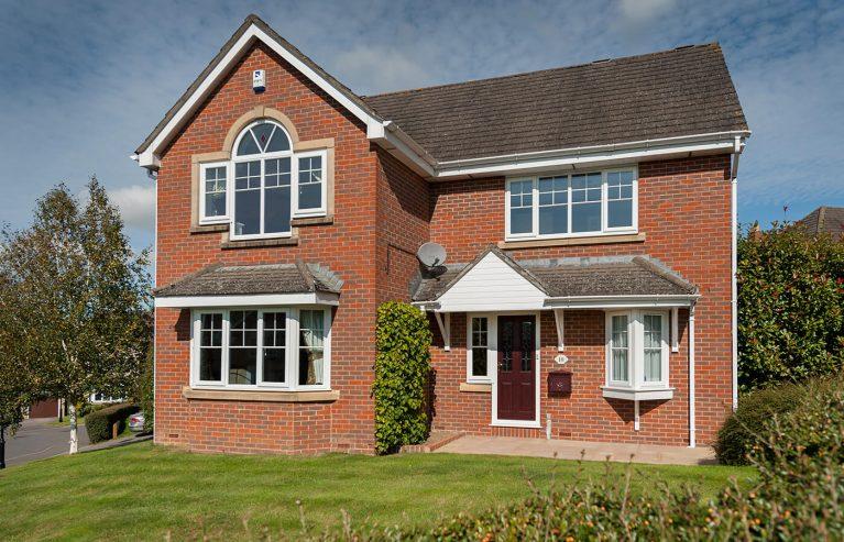 Red brick house with uPVC casement windows
