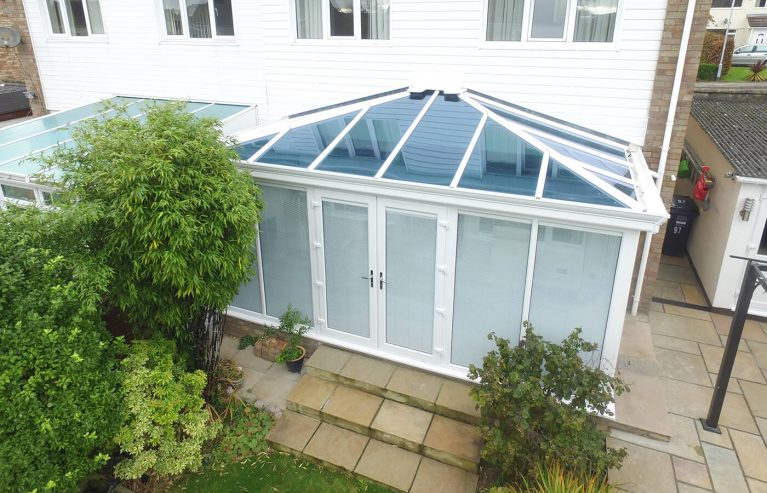 White uPVC Edwardian conservatory with a tinted glass roof
