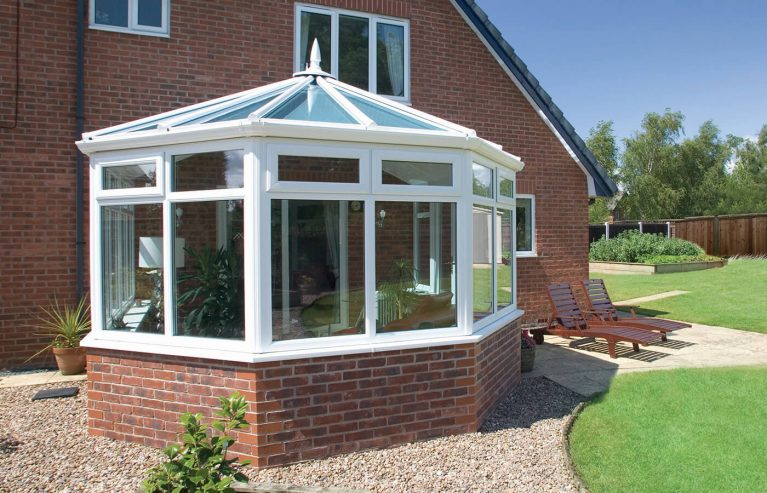 White uPVC Victorian conservatory with a glass roof