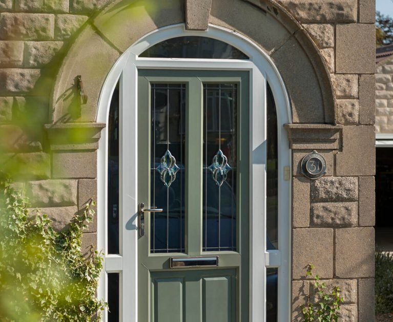 Chartwell Green UPVC entrance door.