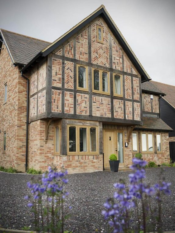 A traditional property with oak colour uPVC windows