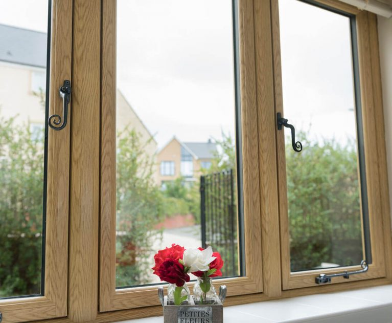 Irish Oak Flush Sash windows with Monkey Tail handles.