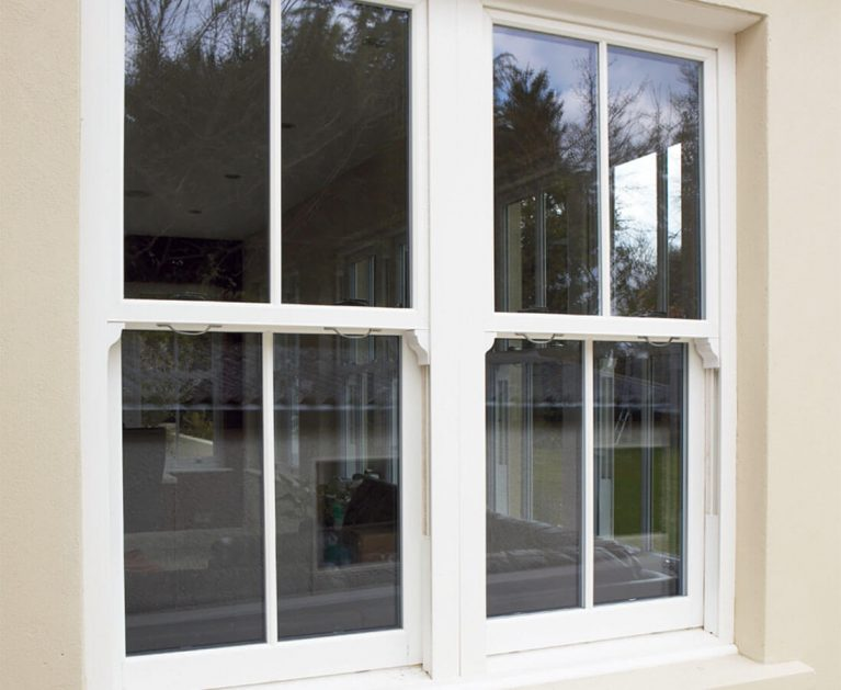 White UPVC vertical sliding window sash horns.