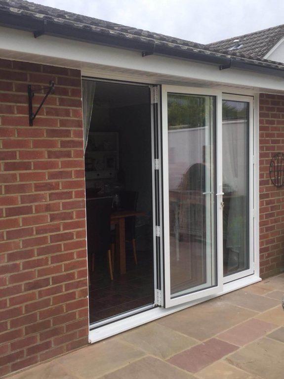 White aluminium bifold door installation