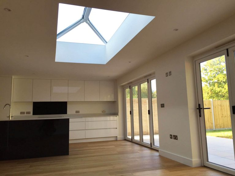 Extension with a white roof lantern