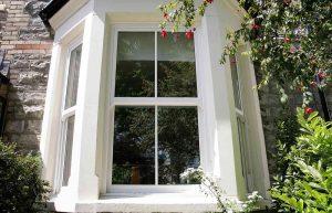 Vertical sliding bow window