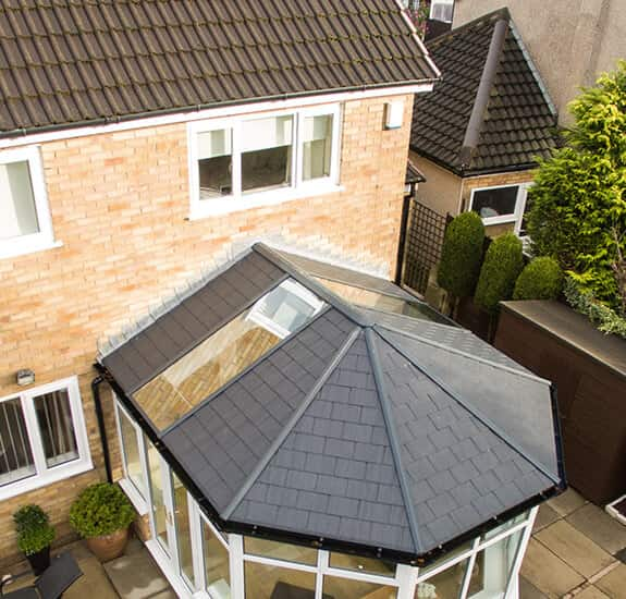 Victorian conservatory with a black tiled roof