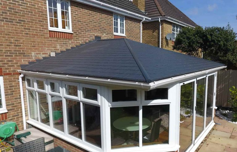 Large black tiled conservatory roof