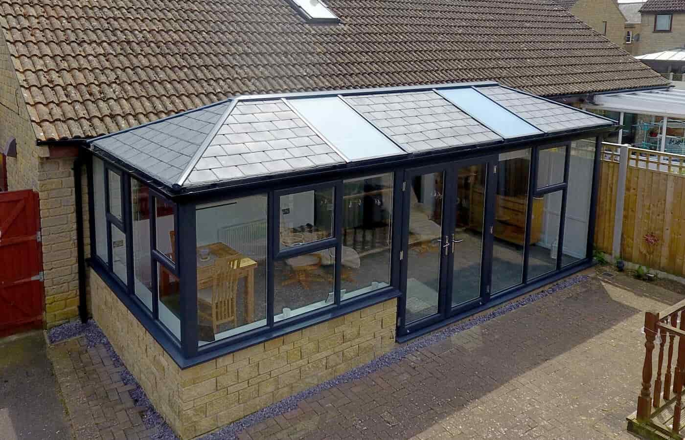 Large conservatory with a grey tiled roof