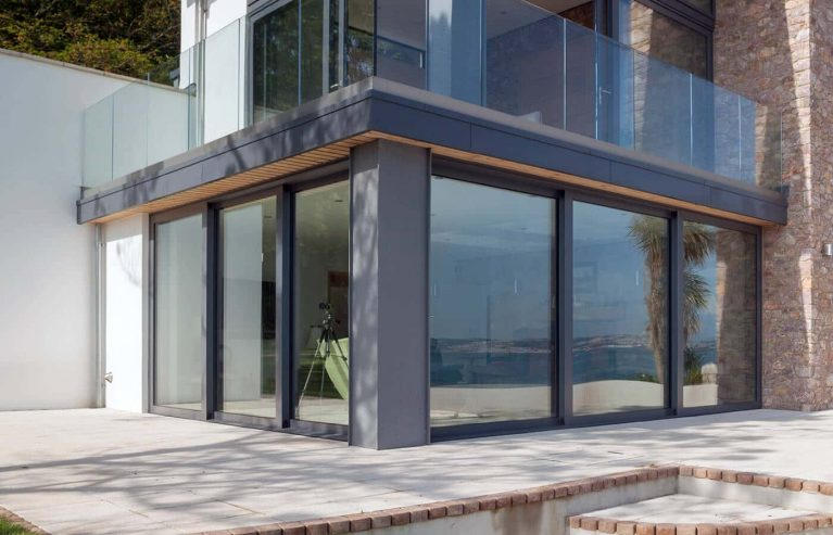 Large grey aluminium sliding patio doors