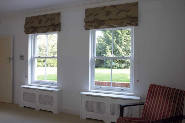 White UPVC vertical slider window with sash pulls.